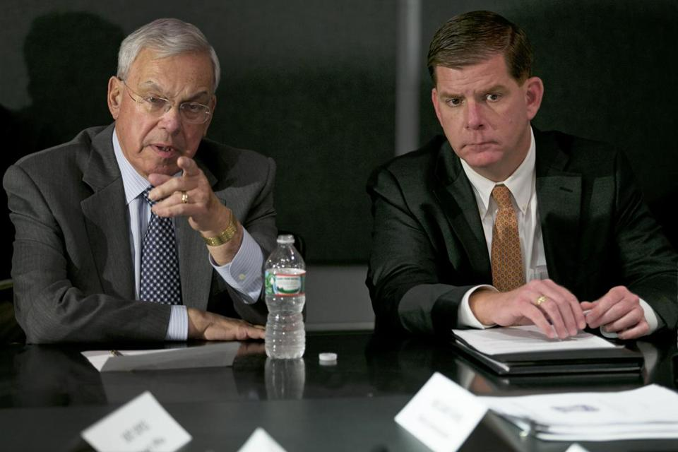 Thomas Menino, left, spoke with department heads alongside Mayor-Elect Martin Walsh in 2013.